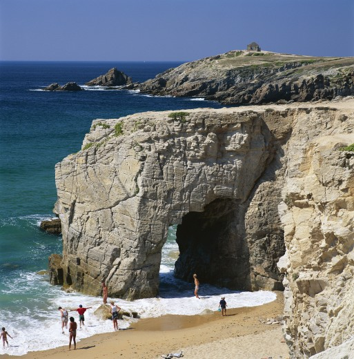 France, Brittany, Quiberon Peninsula, Beach with natural rock arch in sea : Stock Photo