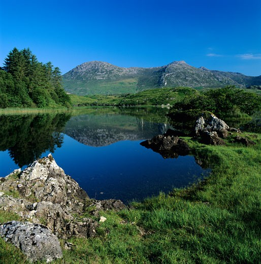 Ireland, County Galway, Connemara National Park, View over lake and mountains in National Park : Stock Photo