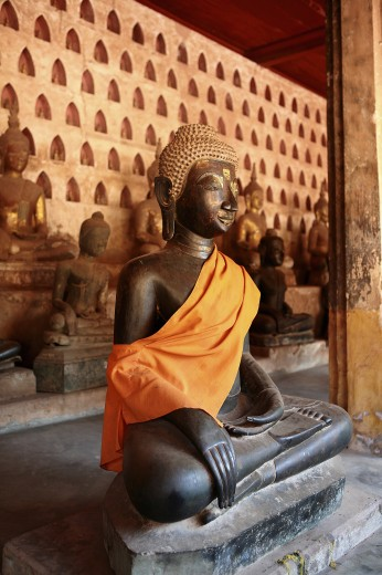 Stock Photo: 1885-12957 Laos, , Vientiane, Bronze Buddha statue at Wat Si Saket