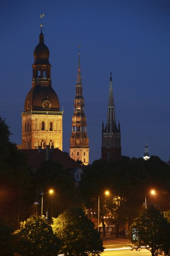 Latvia, , Riga, Lutheran Cathedral and St Peters Church and St Saviours Church in the Old Town at night : Stock Photo