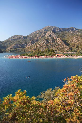 Turkey, Mediterranean, Oludeniz, View over Blue Lagoon to beach and mountains : Stock Photo