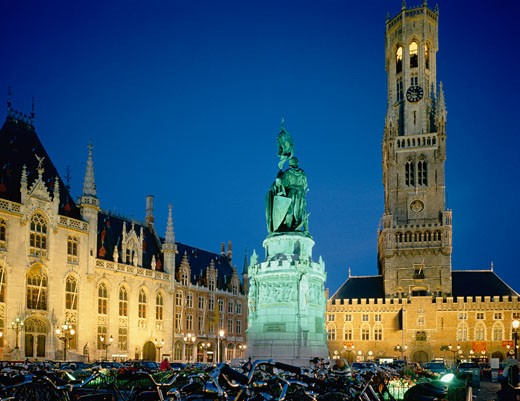 Belgium, Flanders, Bruges, The Grote Market at night with floodlit statue : Stock Photo
