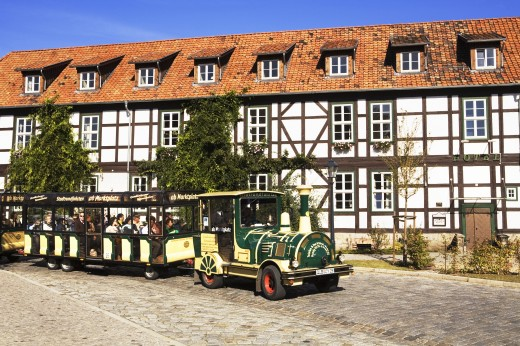 Germany, Saxony-Anhalt, Quedlinburg, Half-timbered houses and tourist train : Stock Photo