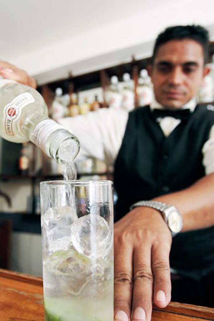 Caribbean, Cuba, Cienfuegos, Bartender making a Mojito : Stock Photo