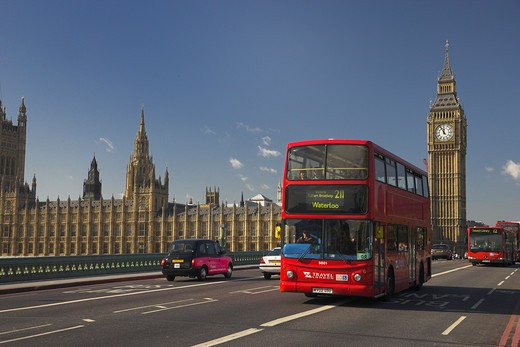 Stock Photo: 1885-21658 UK - England, London, London, London Red Buses crossing Westminster Bridge with Big Ben and the Houses of Parliament in the distance