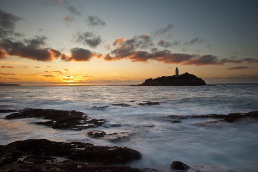 Stock Photo: 1885-21781 UK - England, Cornwall, St Ives, High Tide at Sunset, Godrevy Point and Lighthouse, St Ives Bay, North Cornwall
