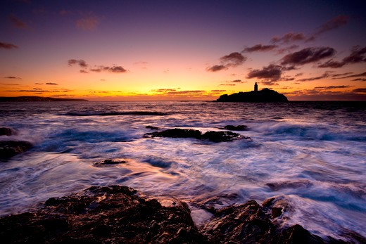 UK - England, Cornwall, St Ives, High Tide at Sunset, Godrevy Point and Lighthouse, St Ives Bay, North Cornwall : Stock Photo