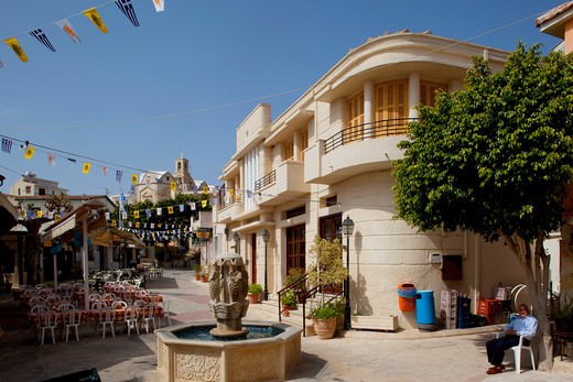 Cyprus, South Cyprus, Paphos, Cyprus. Pissouri; Village Centre & church; : Stock Photo