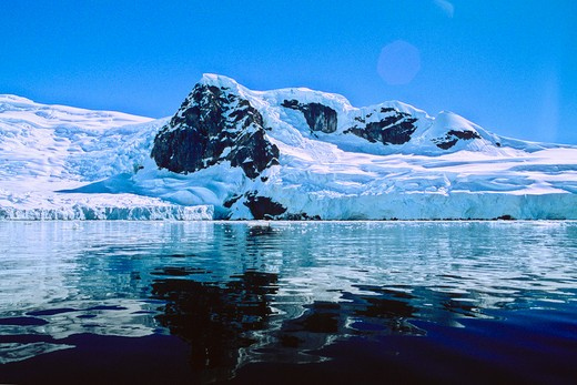 Antarctica; Antarctic Peninsula, Mirror calm water showing reflection ice glacier coastline in Antarctica : Stock Photo