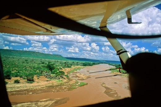 Kenya, Light Aircraft Flying over Tsavo River, Tsavo East National Park : Stock Photo