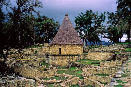 Peru, Pre Columbian Ruins predating Inca from Chachapoyan Civilization at Kuelap fortress - showing reconstructed ancient stone round house from original ruins : Stock Photo