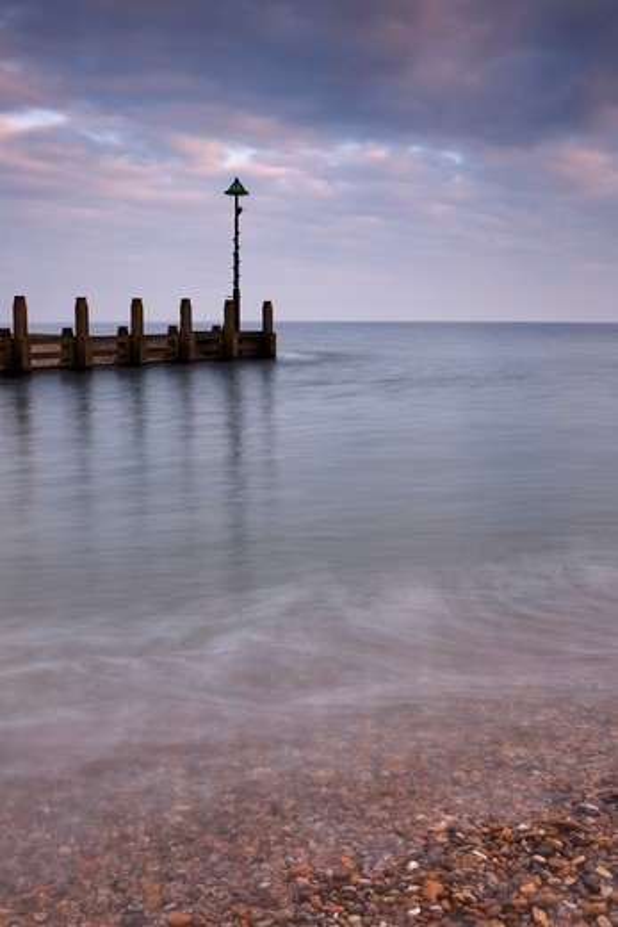 UK - England, Devon, Seaton, Sea groyne at entrance of River Axe : Stock Photo