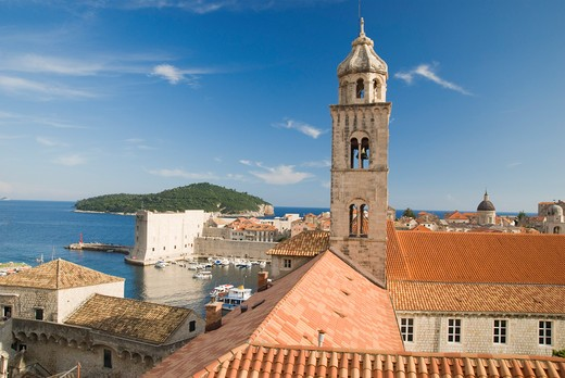 Croatia, Dubrovnik, Dubrovnik, A view towards the bell tower of a Dominican monastery in Dubrovnik with the city harbour below : Stock Photo
