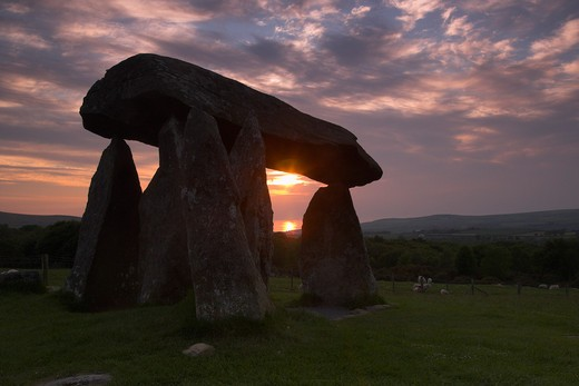 UK - Wales, Pembrokshire, Newport, The Sun Setting Through the Stones of Pentre Ifan : Stock Photo