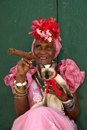 Caribbean, Cuba, Havana, Cuban lady with a cigar : Stock Photo