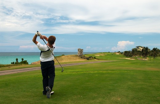 Caribbean, Cuba, Varadero, Golfer and ocean view at the Varadero Golf Club : Stock Photo