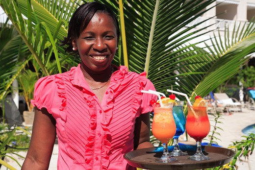 Caribbean, Barbados, St Michael, Local lady and colourful cocktails : Stock Photo