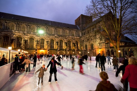 UK - England, Hampshire, Winchester, Christmas Ice Skating Rink outside Winchester Cathedral : Stock Photo