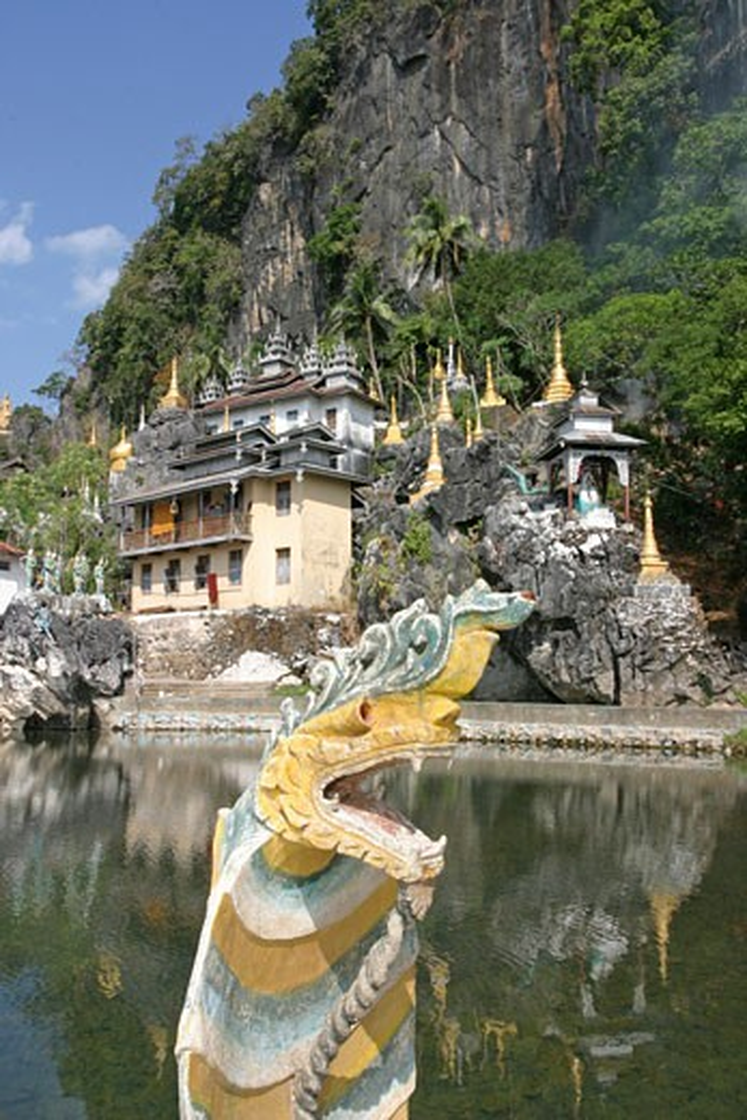 Stock Photo: 1885-9377 Burma, , Moulmein - near, A wayside monastery with dragon statue