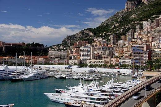 Monaco, Cote d'Azur, Monte Carlo, Yachts in harbour at Port Hercule : Stock Photo