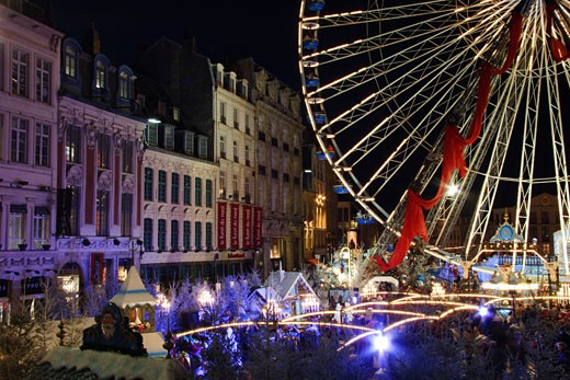 France, Nord pas de Calais, Lille, Grande-Place and ferris wheel at night  : Stock Photo