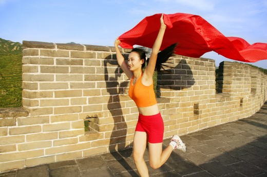 Stock Photo: 1886-11438 female athlete running on Great Wall