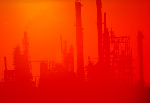 Stock Photo: 1886-37574 Oil refinery silhouette with sunset in background, New Mexico.