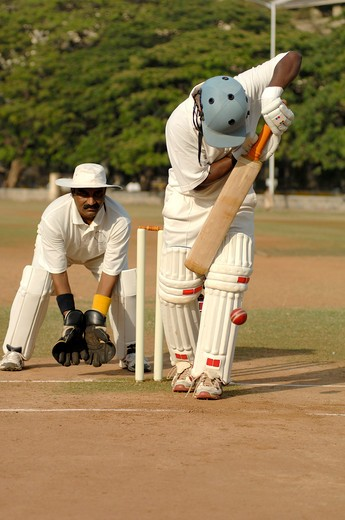 Stock Photo: 1886-47500 Indian right handed batsman in action playing ball about to hit pad showing lbw in cricket match