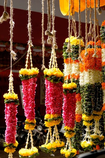 Stock Photo: 1886-47575 Colorful garlands of various sizes and flowers for sale Late Mrs. Meenatai Thackeray flower market at Dadar, Bombay Mumbai, Maharashtra, India