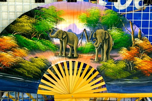 Stock Photo: 1886-47651 Elephant motif on bamboo fan on sale at Buddha temple site Bangkok ; Thailand ; South East Asia