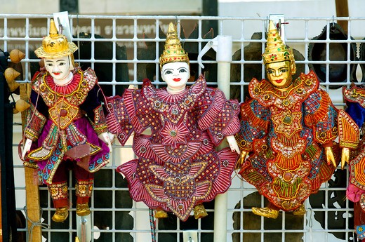 Stock Photo: 1886-47653 Dolls with traditional Thai costumes on sale at Buddha temple site Bangkok ; Thailand ; South East Asia