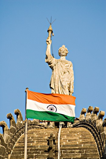 Statue of Queen Empress with national flag at  the Chhatrapati Shivaji Terminus railway station or Victoria Terminus ; listed as UNESCO World Heritage ; Mumbai  Bombay ; Maharashtra ; India : Stock Photo