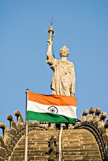 Stock Photo: 1886-47842 Statue of Queen Empress with national flag at  the Chhatrapati Shivaji Terminus railway station or Victoria Terminus ; listed as UNESCO World Heritage ; Mumbai  Bombay ; Maharashtra ; India