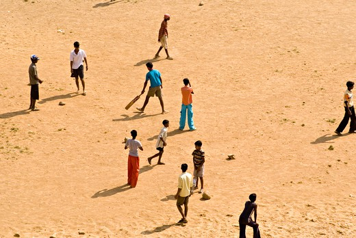 Boys playing cricket on play ground Alica Nagar ; Lokhandwala township ; Akurli Road ; Kandivali ; Mumbai  Bombay ; Maharashtra ; India : Stock Photo