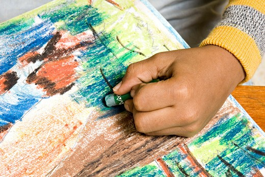 South Asian Indian eight year old boy Dhruv Karve filling color in painting in her house ; Bombay Mumbai ; Maharashtra ; India MR#688 : Stock Photo