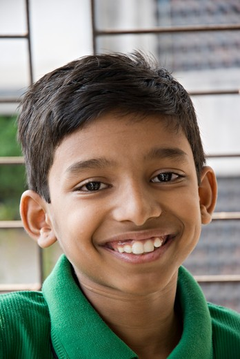 Stock Photo: 1886-48006 South Asian Indian eight year old boy smiling ; Bombay Mumbai ; Maharashtra ; India MR#688