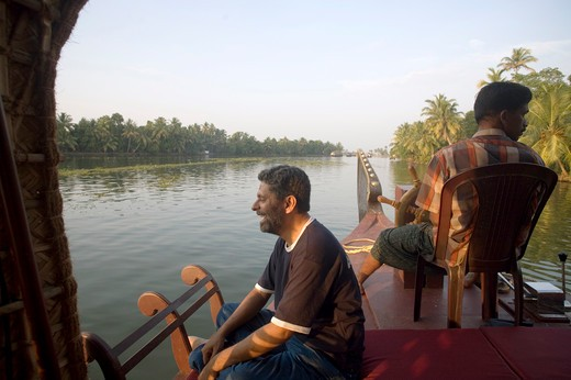 Stock Photo: 1886-48741 Photographer Ravi Shekar sitting on boat looking view of Backwaters ; Alleppey ; Kerala ; India MR#202