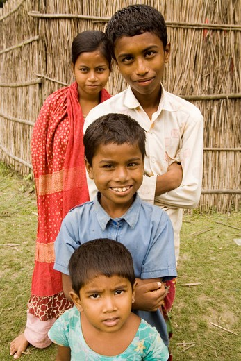 Boys and girls posing for pictures ; village Tauta; district Manikgunj ; Bangladesh : Stock Photo