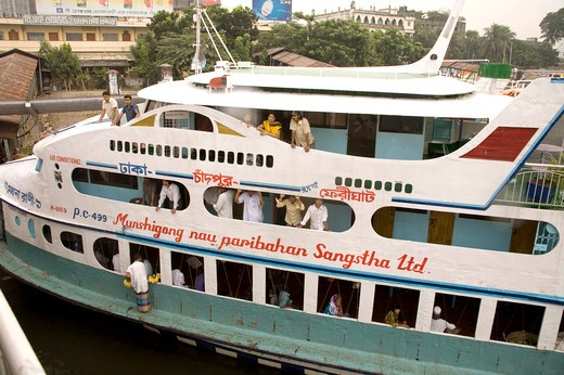 Stock Photo: 1886-48807 People traveling in cruise boat in Burigunga Buri Gunga River ; Sadarghat Boat terminal ; Dhaka ; Bangladesh