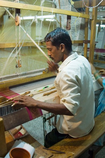Weaver weaving silk handloom ; Kanchipuram ; Tamilnadu ; India : Stock Photo