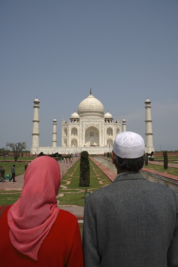 Stock Photo: 1886-49975 Kashmiri couple viewing at Taj Mahal Seventh Wonders of World on the south bank of Yamuna river ; Agra ; Uttar Pradesh ; India UNESCO World Heritage Site