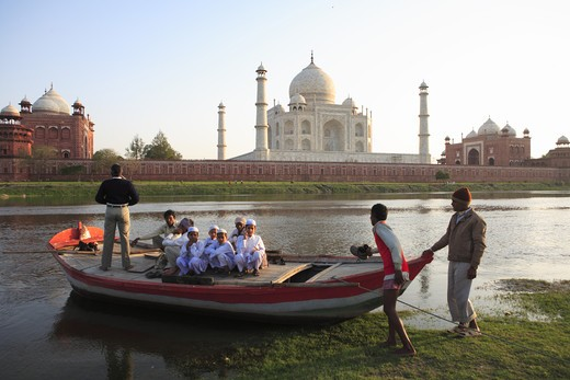Stock Photo: 1886-50009 Villagers in boat in river Yamuna at Taj Mahal Seventh Wonders of World ; Agra ; Uttar Pradesh ; India UNESCO World Heritage Site