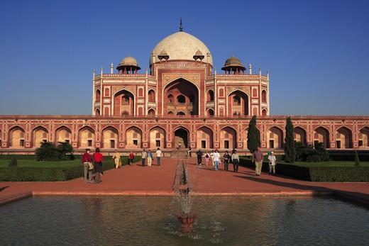 Tourists at Humayun's tomb built in 1570 made from red sandstone and white marble first garden-tomb on Indian subcontinent persian influence in mughal architecture ; Delhi; India UNESCO World Heritage Site : Stock Photo
