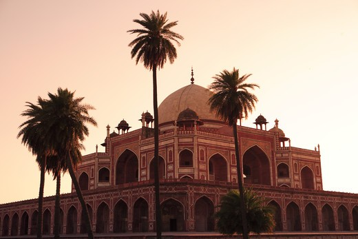 Stock Photo: 1886-50059 Evening view of Humayun's tomb built in 1570 made from red sandstone and white marble first garden-tomb on Indian subcontinent persian influence in mughal architecture ; Delhi; India UNESCO World Heritage Site
