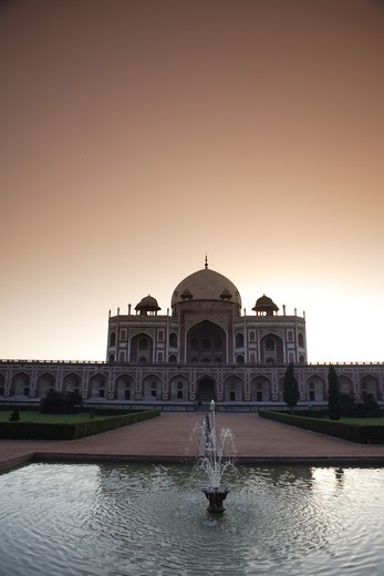Sunrise at Humayun's tomb built in 1570 made from red sandstone and white marble first garden-tomb on the Indian subcontinent persian influence in mughal architecture ; Delhi ; India UNESCO World Heritage Site : Stock Photo