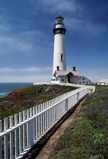 Stock Photo: 1886-50294 White picket fence leading to Pidgeon Point Lighthouse north of Santa Cruz, California.  The lighthouse was built in 1871.