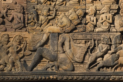Stock Photo: 1886-50909 Banteay Srei with bas relief in red sandstone showing Ravana shaking Mount Kailasa (E pediment of S Library), 10th century Khmer  architecture at Angkor Wat -  Siem Reap, Cambodia