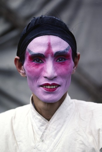 Stock Photo: 1886-51337 CHINESE OPERA ACTOR with makeup but no costume on before a performance in the farming town of DALI - YUNNAN, CHINA