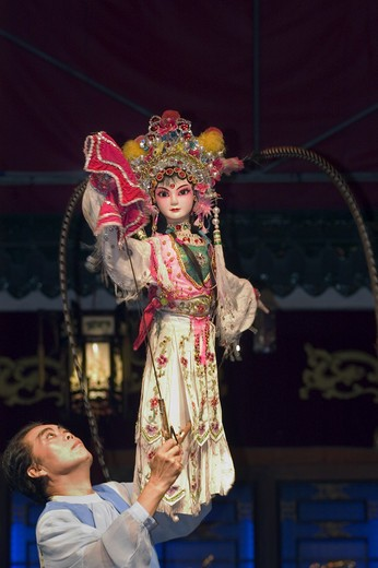 Stock Photo: 1886-51440 Female Puppet & puppeteer in a traditional Chinese Puppet Show - Chengdu, China in Sichuan Province