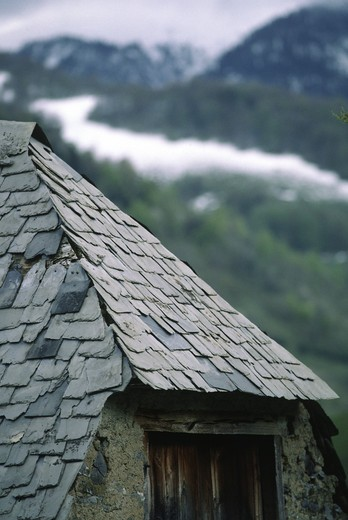 Stock Photo: 1886-51684 DETAIL of STONE SHINGLED ROOF and FARM HOUSE - PYRENEES MOUNTAINS, FRANCE
